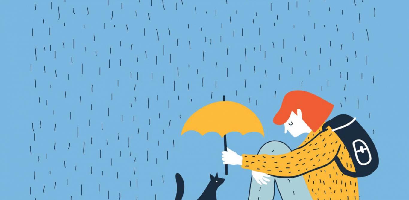 Symbolbild: Person sitzt alleine im Regen