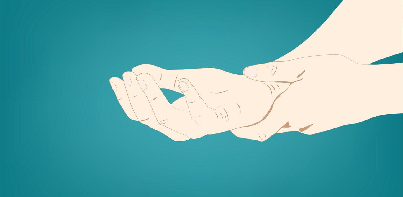 Sehnenscheidenentzündung: Eine Person hält ihr Handgelenk