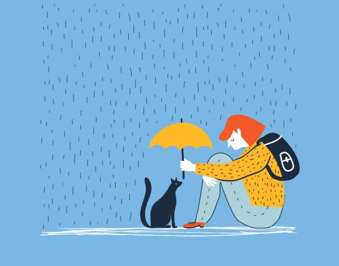 Winterdepression: Eine Frau sitzt mit Katze und Schirm am Boden.